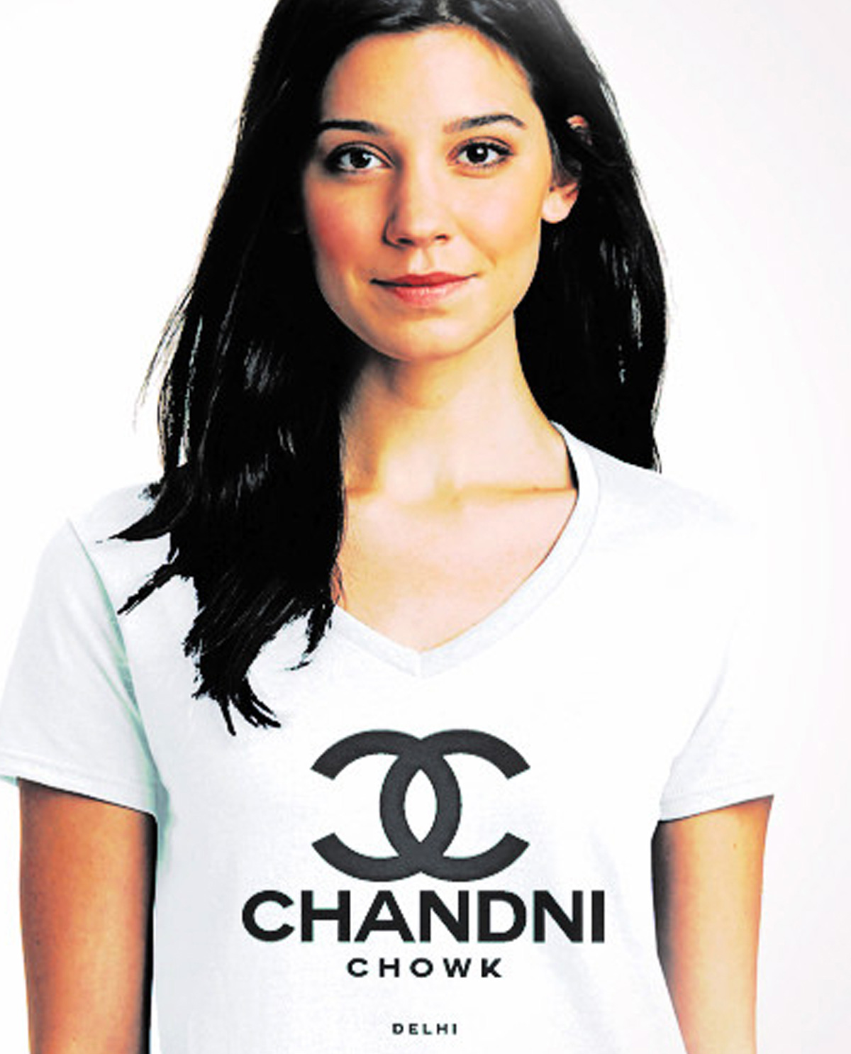 South Asian female model wearing Chandni Chowk white V neck graphic design t.shirt printed super Gildan SoftStyle t.shirt. South Asian Desi Themed Graphic Design t.shirts by Brown Man Clothing Co.