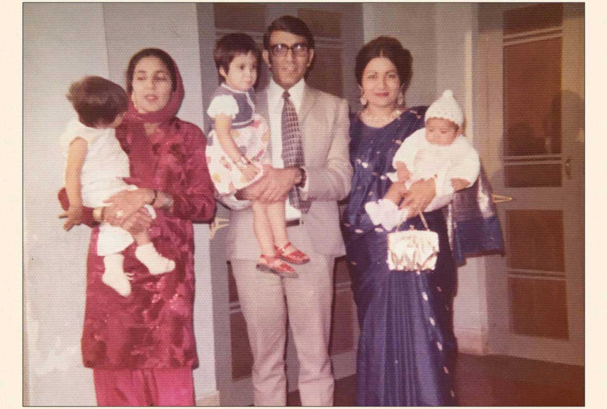 Picture from 1970 of a South Asian family holding young children.