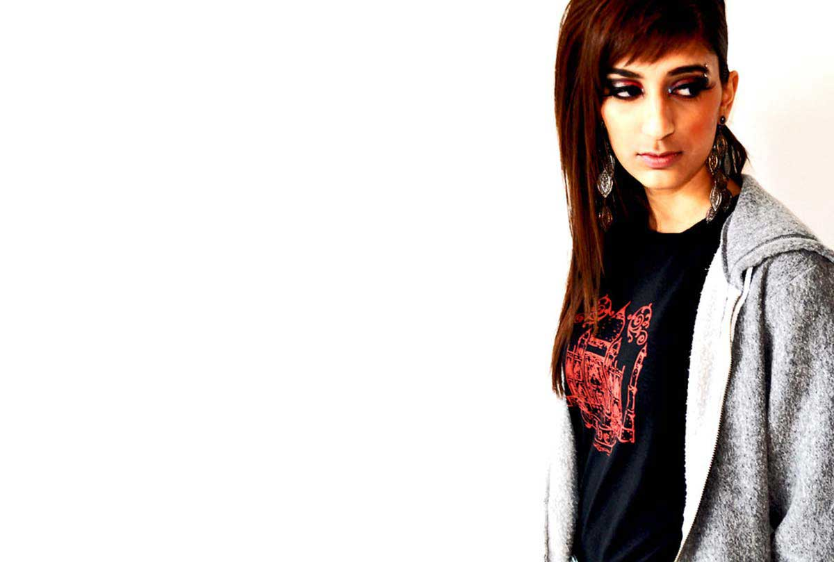 South Asian Female Model Wearing Graphic Design Tshirt with image of Taj Mahal on front.