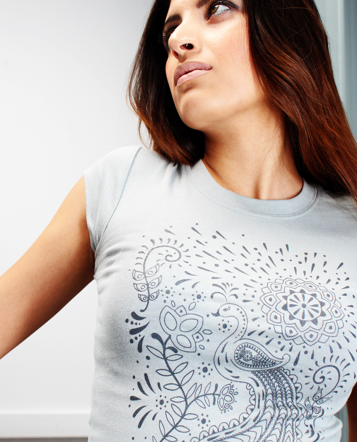 South Asian female model wearing Mendhi Peacock graphic design sheer extra long fitted t.shirt. South Asian Desi Themed Graphic Design t.shirts by Brown Man Clothing Co.