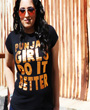 Female model wearing black fitted graphgic design tshirt with Punjabi Girls Do It Better written on the front in block lettering with copper foil design.
