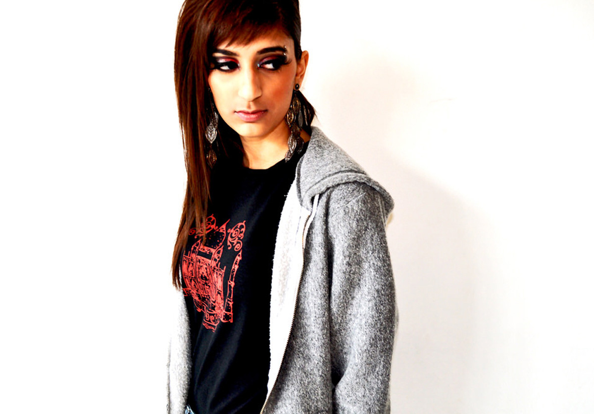 South Asian female model wearing black fitted Taj Mahal Graphic Design Tshirt by Brown Man Clothing Co.